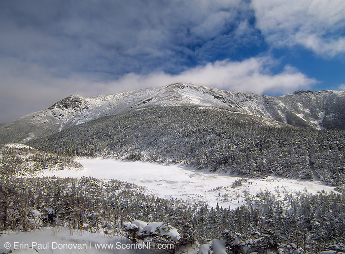 The snow covered Eagle Lake with Mount Lafayette in the background from along Greenleaf Trail in the White Mountains of New Hampshire. The Appalachian Trail travels over this exposed ridge.