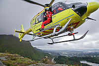 Crew from Norwegian Air Ambulance fly a training mission in the Bergen area. Doctor Bård Einar Heradstveit at the door. Pilot Marius Malmo.<br />