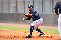 FCL Tigers East first baseman Danuerys De La Cruz (13) stretches for a throw during a game against the FCL Yankees on July 27, 2021 at the Yankees Minor League Complex in Tampa, Florida. (Mike Janes/Four Seam Images)