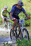Gerard Malcolm (87) and Nigel Rogers(185) going through the first ford. Mammoth Adventure MTB Ride, Nelson<br /> Photo: Marc Palmano/shuttersport.co.nz