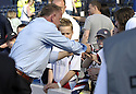 30/05/2009  Copyright  Pic : James Stewart.sct_jspa_14_rangers_v_falkirk.FALKIRK MANAGER JOHN HUGHES GIVES HIS TIE TO A FAN AT THE END OF THE GAME.James Stewart Photography 19 Carronlea Drive, Falkirk. FK2 8DN      Vat Reg No. 607 6932 25.Telephone      : +44 (0)1324 570291 .Mobile              : +44 (0)7721 416997.E-mail  :  jim@jspa.co.uk.If you require further information then contact Jim Stewart on any of the numbers above.........