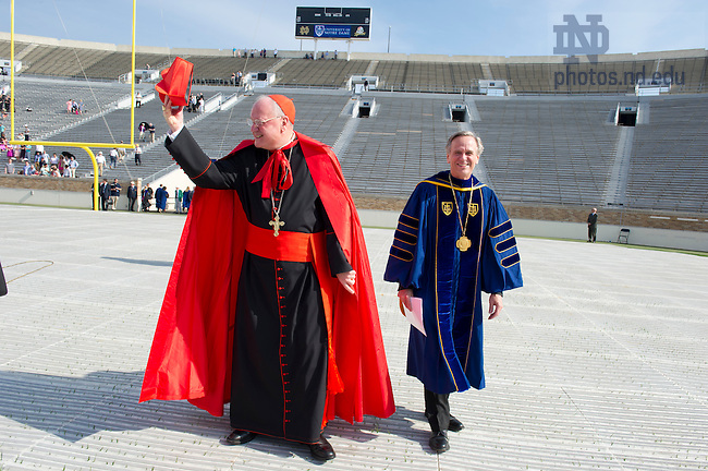 May 19, 2013; Timothy Cardinal Dolan, Archbishop of New York and Commencement speaker walks to the stage with Rev. John I. Jenkins, C.S.C., president of the University of Notre Dame before the 2013 Commencement ceremony in Notre Dame Stadium. Photo by Barbara Johnston/University of Notre Dame