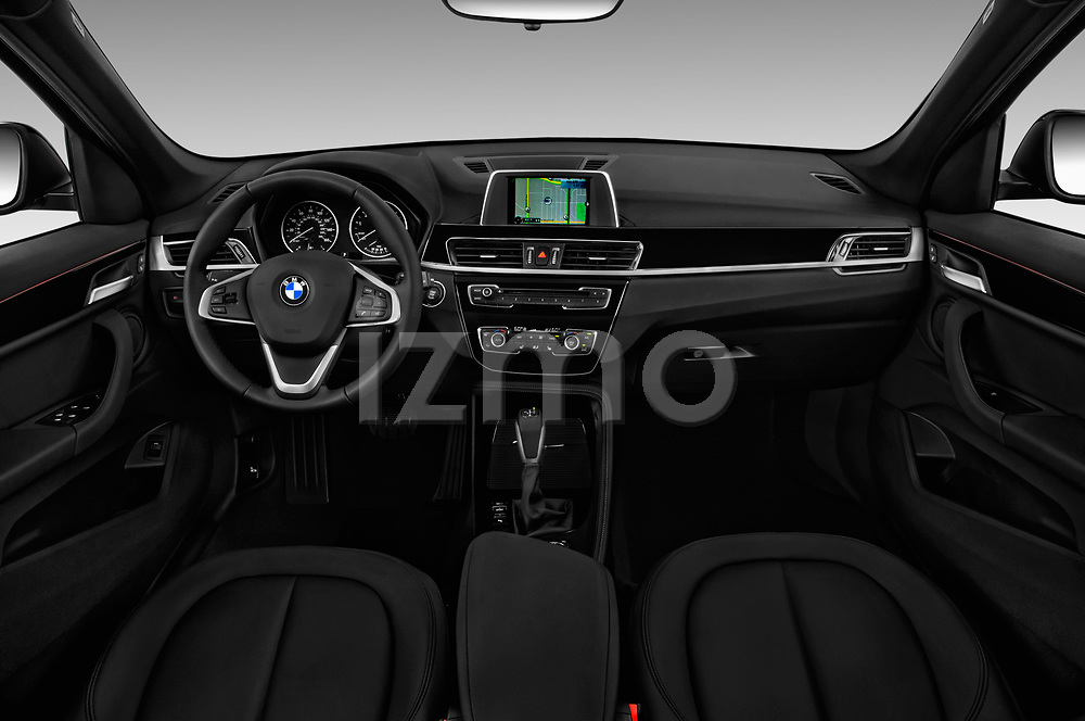 Stock photo of straight dashboard view of a 2018 BMW X1 xDrive28i 5 Door SUV