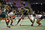 Berlin, Germany, February 01: Katharina Windfeder #8 of HTC Uhlenhorst Muehlheim defends the ball during the 1. Bundesliga Damen Hallensaison 2014/15 final hockey match between Duesseldorfer HC (white) and HTC Uhlenhorst Muehlheim (green) on February 1, 2015 at the Final Four tournament at Max-Schmeling-Halle in Berlin, Germany. Final score 4-1 (1-0). (Photo by Dirk Markgraf / www.265-images.com) *** Local caption ***