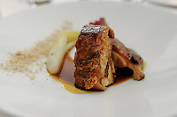 The main course of piglet with braised endive, chestnuts and mandarin and coffee sauce € 20 at Pappagallo, Bologna. The Pappagallo Restaurant in Bologna was established in 1919. It continues to serve traditional Bolognese cuisine. Photo Sydney Low