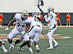 Baylor Bears quarterback Robert Griffin III (10) and Baylor Bears center Philip Blake (74) in action during the game between the Baylor Bears and the Oklahoma State Cowboys at the Boone Pickens Stadium in Stillwater, OK. Oklahoma State defeats Baylor 59 to 24.