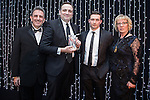 © Joel Goodman - 07973 332324 . 05/03/2015 .  Midland Hotel , Manchester , UK . L-R Eamonn O'Neill , winner Kevin Clarke of Bott and Co Solicitors , sponsor (Interlink Recruitment) and Louise Straw . Associate of the Year . The Manchester Legal Awards 2015 . Photo credit : Joel Goodman