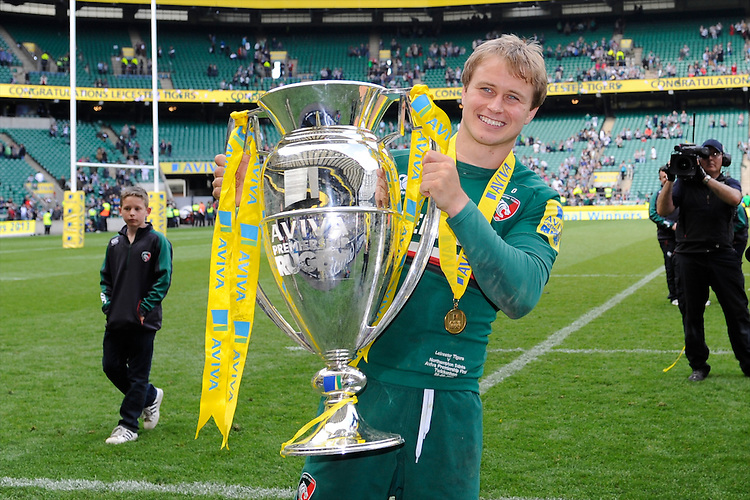 Mathew Tait of Leicester Tigers holds the trophy after the Aviva Premiership Final between Leicester Tigers and Northampton Saints at Twickenham Stadium on Saturday 25th May 2013 (Photo by Rob Munro)