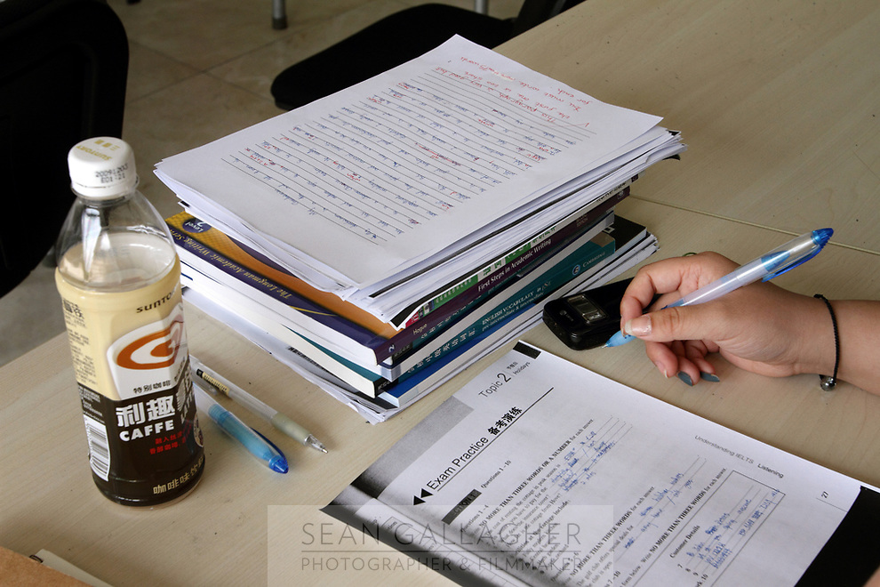 CHINA. Beijing. A student writes notes at Aoji, an organisation which assists Chinese students in language training and placing them in overseas universities throughout the world. 2010