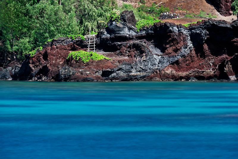 Ladder on cliff with ocean. Hana, Hawaii