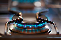 Gas ring burning with blue flame on a gas cooker.