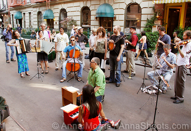 """Make Music New York is a day long musical celebration of the summer solstice. On Monday, June 21st 2010, outside The Cornelia Street Cafe, the Composers Collaborative's Mighty CCi House Band performed Terry Riley's work """"In C"""".  http://www.nytimes.com/2010/06/23/arts/music/23riley.html?scp=6&sq=June+23,+2010&st=nyt"""