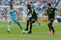 ST PAUL, MN - JULY 24: Robin Lod #17 of Minnesota United FC and Dairon Asprilla #27 of the Portland Timbers battle for the ball during a game between Portland Timbers and Minnesota United FC at Allianz Field on July 24, 2021 in St Paul, Minnesota.