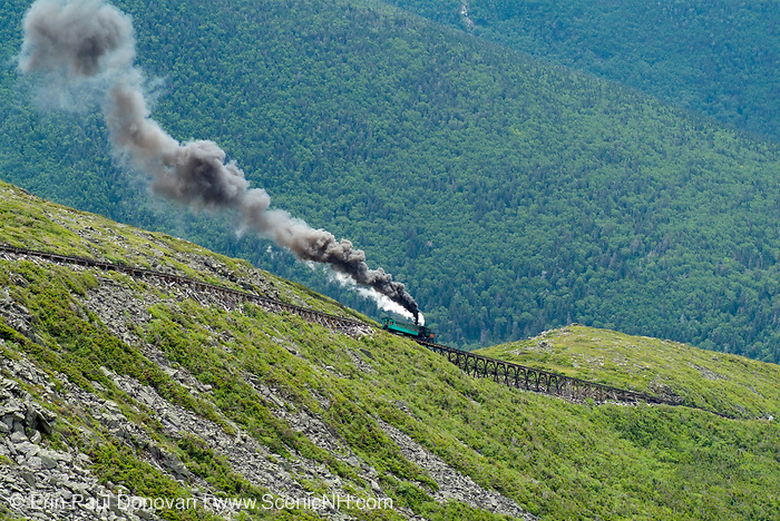 The Mount Washington Cog Railroad ascending Mount Washington during the summer months in the scenic landscape of the White Mountains, New Hampshire USA