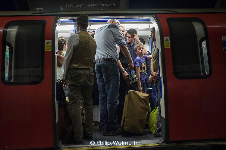 Crowded London Underground train.