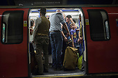 Crowded London Underground train.