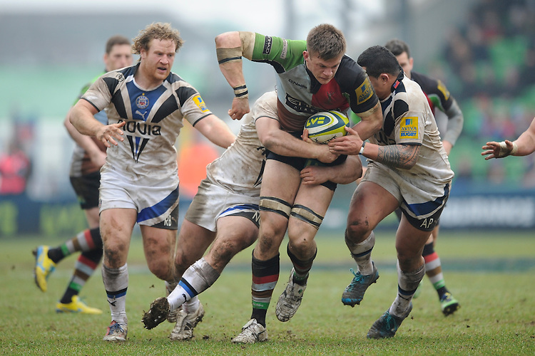 20130309 Copyright onEdition 2013©.Free for editorial use image, please credit: onEdition..Sam Twomey of Harlequins is tackled by Anthony Perenise of Bath Rugby during the LV= Cup semi final match between Harlequins and Bath Rugby at The Twickenham Stoop on Saturday 9th March 2013 (Photo by Rob Munro)..For press contacts contact: Sam Feasey at brandRapport on M: +44 (0)7717 757114 E: SFeasey@brand-rapport.com..If you require a higher resolution image or you have any other onEdition photographic enquiries, please contact onEdition on 0845 900 2 900 or email info@onEdition.com.This image is copyright onEdition 2013©..This image has been supplied by onEdition and must be credited onEdition. The author is asserting his full Moral rights in relation to the publication of this image. Rights for onward transmission of any image or file is not granted or implied. Changing or deleting Copyright information is illegal as specified in the Copyright, Design and Patents Act 1988. If you are in any way unsure of your right to publish this image please contact onEdition on 0845 900 2 900 or email info@onEdition.com