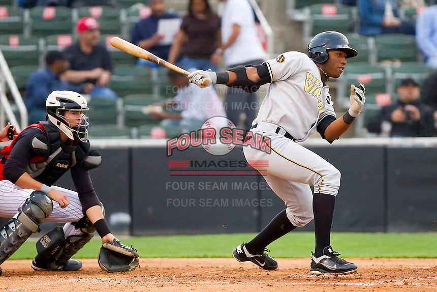 Mel Rojas Jr. #24 of the West Virginia Power follows through on his swing against the Kannapolis Intimidators at Fieldcrest Cannon Stadium on April 21, 2011 in Kannapolis, North Carolina.   Photo by Brian Westerholt / Four Seam Images