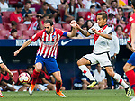 Diego Roberto Godin Leal (C) of Atletico de Madrid battles for the ball with Oscar Guido Trejo (R) of Rayo Vallecano during the La Liga 2018-19 match between Atletico de Madrid and Rayo Vallecano at Wanda Metropolitano on August 25 2018 in Madrid, Spain. Photo by Diego Souto / Power Sport Images