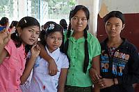 Myanmar, Burma.  Mingun, near Mandalay.  Young Burmese Girls Visiting the Mingun Bell, largest hung uncracked bell in the world.