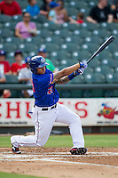 Round Rock Express outfielder Michael Choice (20) swings the bat during the first game of a Pacific Coast League doubleheader against the Memphis Redbirds on August 3, 2014 at the Dell Diamond in Round Rock, Texas. The Redbirds defeated the Express 4-0. (Andrew Woolley/Four Seam Images)