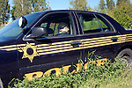 Police maniquin snoozes away the days in the small Palouse town of Garfield, Washington.  Palouse Region.