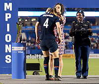 FRISCO, TX - MARCH 11: Becky Sauerbrunn #4 of the United States receives her medal during a game between Japan and USWNT at Toyota Stadium on March 11, 2020 in Frisco, Texas.