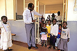 Head of Hospital Showing Us Young Patients' Illnesses, Nyanza Provincial General Hospital