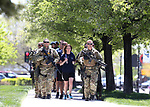 Las Vegas Metropolitan Police Department Correctional Officer Kristi Stiegelmeyer runs a baton into the 21st annual Nevada State Law Enforcement Officers Memorial ceremony in Carson City, Nev., on Thursday, May 3, 2018. <br />Photo by Cathleen Allison/Nevada Momentum