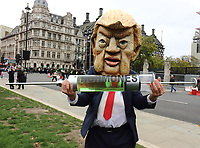 A fake US President Donald Trump, a pantomime cow and people dressed as chickens at the Stop Trump, Stop the post Brexit Trade Deal protest in Parliament Square. <br /> Action against the NHS being opened up permanently to American healthcare companies. Chlorinated chicken AND hormone-laced beef and lowering of food standards. Plus the forced deregulation of  environmental laws and our rights to data privacy. Westminster, London on Saturday October 24th 2020<br /> <br /> Photo by Keith Mayhew