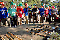 Photo story of Philmont Scout Ranch in Cimarron, New Mexico, taken during a Boy Scout Troop backpack trip in the summer of 2013. Photo is part of a comprehensive picture package which shows in-depth photography of a BSA Ventures crew on a trek.  In this photo a BSA Venture Crew listen to instructions  before beginning to clear a new trail being cut during the Venture Crews conservation project in the backcountry at Philmont Scout Ranch.   <br /> <br /> The  Photo by travel photograph: PatrickschneiderPhoto.com