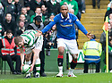 :: RANGERS' EL HADJI DIOUF PLEADS FOR A FOUL AFTER BEING CHALLENGED BY CELTIC'S MARK WILSON ::