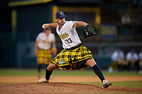 Savannah Bananas pitcher Nolan Daniel (33) during a Coastal Plain League game against the Macon Bacon on July 15, 2020 at Grayson Stadium in Savannah, Georgia.  Savannah wore kilts for their St. Patrick's Day in July promotion.  (Mike Janes/Four Seam Images)