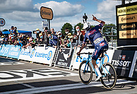 Mathieu Van der Poel (NED/Alpecin-Fenix) saluting  his famous grandfather Raymond Poulidor as he crosses the finish line and thus achieving something 'Poupou' never did; winning the yellow jersey...<br /> <br /> Stage 2 from Perros-Guirec to Mûr-de-Bretagne, Guerlédan (184km)<br /> 108th Tour de France 2021 (2.UWT)<br /> <br /> ©kramon