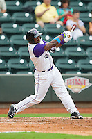 Courtney Hawkins (10) of the Winston-Salem Dash follows through on his swing against the Frederick Keys at BB&T Ballpark on July 21, 2013 in Winston-Salem, North Carolina.  The Dash defeated the Keys 3-2.  (Brian Westerholt/Four Seam Images)