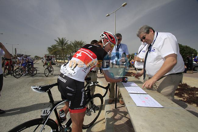 Radioshack-Nissan Trek rider Fabian Cancellara (SUI) signs on before the start of the 3rd Stage of the 2012 Tour of Qatar running 146.5km from Dukhan Souq, Dukhan to Al Gharafa, Qatar. 7th February 2012.<br /> (Photo Eoin Clarke/Newsfile)