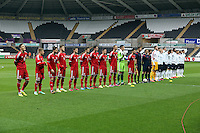 Pictured: Wales and England team players pose for a picture before kick off. Monday 19 May 2014<br />