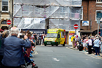 BNPS.co.uk (01202) 558833<br /> Pic: Zachary Culpin/BNPS<br /> <br /> Pictured: John's old van leads the convoy driven by his daughter Jemma<br /> <br /> A much-loved ice cream seller was given a fitting send off by colleagues who followed his funeral cortege in a convoy of 10 ice cream vans. <br /> <br /> John Lennie spent over 40 years selling ice creams from his trusty van in his local community.<br /> <br /> So dedicated was he to his job that he was still doing his rounds just two days before he died at the age of 79.<br /> <br /> His daughter, Jemma Lennie, led the procession in her father's old colourful truck at his funeral in Wimborne, Dorset.