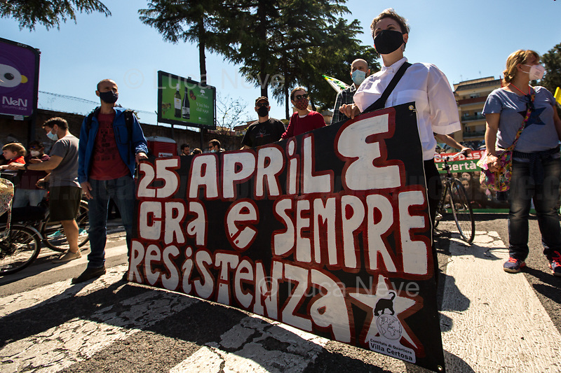 Rome, Italy. 25th Apr, 2021. Today, to mark the 76th Anniversary of the Italian Liberation from nazi-fascism (Liberazione), Azione Antifascista Roma Est, supported by ANPI Centocelle (National Association of Italian WWII Partizans), and various Antifascist organizations, movements, students, political parties, social centres, held a march (Corteo) from Piazza delle Camelie to Villa Gordiani's Park (1.), in Centocelle's district. The demonstration began with a rally in front of the Memorial dedicated to the Partizans of Centocelle victims of nazi-fascist occupation troops and retaliations, where Partizans and their relatives, activists, historians gave speeches to remember the population struggle and solidarity, to keep the memory and the lesson of the Resistenza alive and to reaffirm the values of Freedom and Justice of the Italian Antifascist Constitution as the only way to fight against fascist pulsions re-appearing all over the world.  <br />