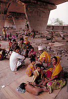 In Calcutta, living conditions are such that poor Indian families often live under bridges. poverty, economic, social conditions. homeless people under bridge. Calcutta, India under bridge in the city.