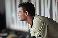 Patrick Frick (5) of the Wake Forest Demon Deacons sits on the bench in the home dugout during the game against the Virginia Cavaliers at David F. Couch Ballpark on May 19, 2018 in  Winston-Salem, North Carolina.  The Demon Deacons defeated the Cavaliers 18-12.  (Brian Westerholt/Four Seam Images)
