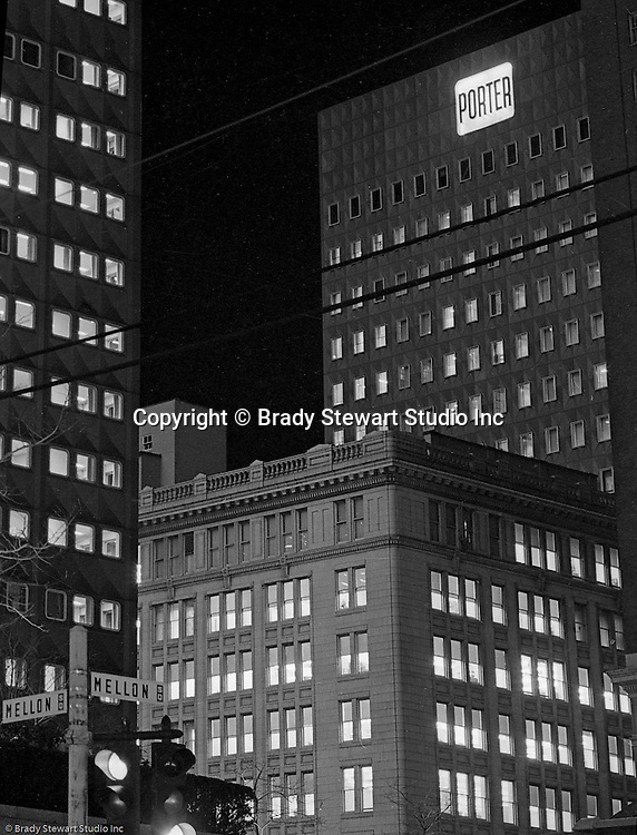 Pittsburgh PA: View of the H.K. Porter Company building and sign at night. HK Porter was known for building locomotives but diversified into many other industries after World War I.  Near the end of the depression, Porter declared bankruptcy and was purchased by Thomas Mellon Evans (part of the Mellon family).