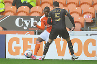 Blackpool's Sullay Kaikai under pressure from Milton Keynes Dons' Regan Poole<br /> <br /> Photographer Kevin Barnes/CameraSport<br /> <br /> The EFL Sky Bet League One - Blackpool v Milton Keynes Dons - Saturday 24 October 2020 - Bloomfield Road - Blackpool<br /> <br /> World Copyright © 2020 CameraSport. All rights reserved. 43 Linden Ave. Countesthorpe. Leicester. England. LE8 5PG - Tel: +44 (0) 116 277 4147 - admin@camerasport.com - www.camerasport.com