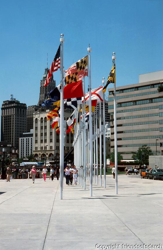 Baltimore:  #15  Inner Harbor--plaza with flagpoles. Photo '85.