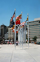 Baltimore:  #15  Inner Harbor--plaza with flagpoles. Photo '85.