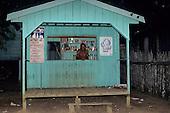 Novo Airao, Rio Negro, Amazon, Brazil. Caboclo village shop with Polio vaccination campaign poster. Amazonas State.