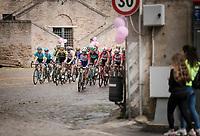 peloton cruising over the cobbles<br /> <br /> Stage 8: Tortoreto Lido to Pesaro (239km)<br /> 102nd Giro d'Italia 2019<br /> <br /> ©kramon