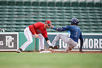 GCL Red Sox third baseman Nicholas Northcut (24) puts a tag on Yunior Martinez (1) as he slides into third base during a game against the GCL Rays on August 1, 2018 at JetBlue Park in Fort Myers, Florida.  GCL Red Sox defeated GCL Rays 5-1 in a rain shortened game.  (Mike Janes/Four Seam Images)