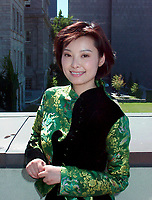 Montreal, 1999-09-01. Chinese actress Yuan Li who plays in the movie ``An Unusual Love`` by famous director Wu Tienming, pose for photographers at a private reception during the World Film Festival in Montreal (Quebec, Canada)