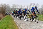 The peloton led by Deceuninck-Quick Step on the Wolvenberg climb during the 76th edition of Omloop Het Nieuwsblad 2021 running 200km from Gent to Ninove, Belgium. 27th February 2021  <br /> Picture: Serge Waldbillig | Cyclefile<br /> <br /> All photos usage must carry mandatory copyright credit (© Cyclefile | Serge Waldbillig)